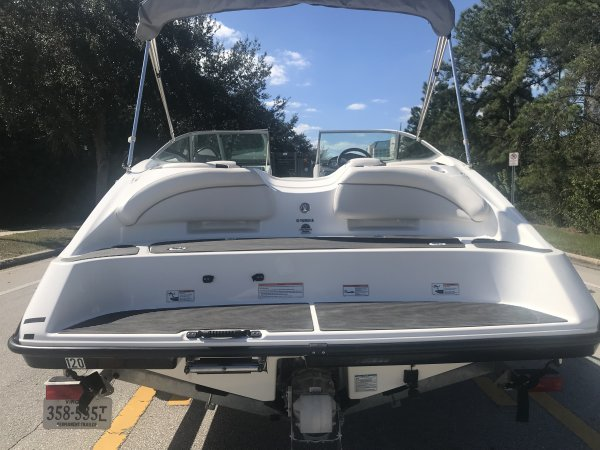 A jetboat is a boat propelled by a jet of water ejected from the back of the craft.  A jetboat draws the water from under the boat into a pump-jet inside the boat, then expels it through a nozzle at the stern.