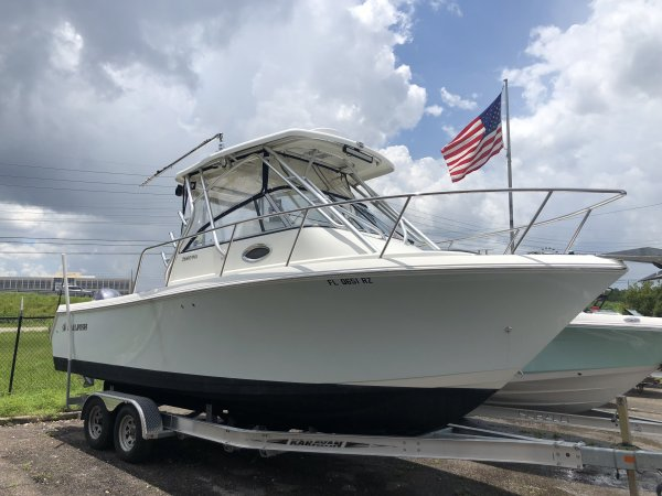 There is a cabin on some center console models.  These cabins are usually located in the bow and hold small berths for sleeping. The boat deck surrounds the console so that a person can walk all around the boat from stern to bow with ease.