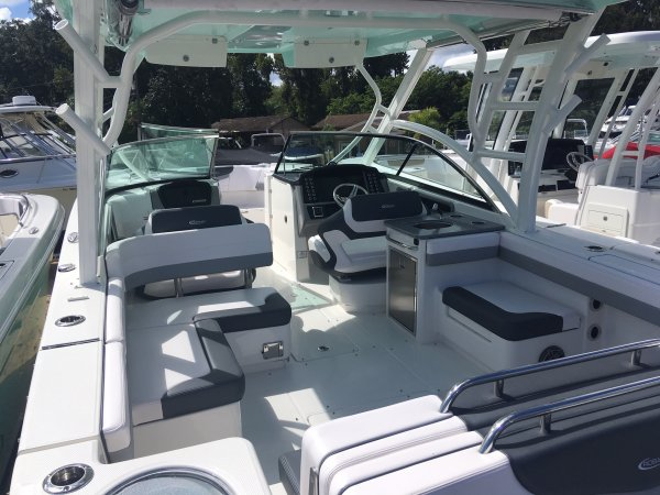 The definition of an outboard motor is a detachable engine mounted on outboard brackets on the stern of your boat.  This configuration will have triple engines.